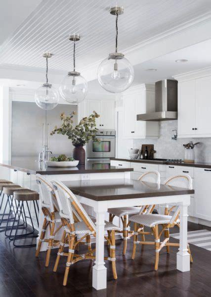 white kitchen  black range hood   gray center