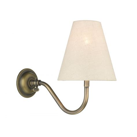 victorian replica wall light in antique brass with linen shade