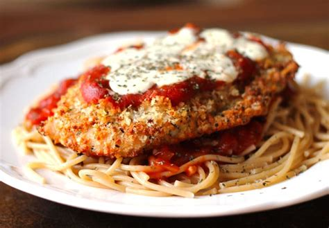 This chicken parmesan is all nestled up with its best friend: Oven-Baked Chicken Parmesan