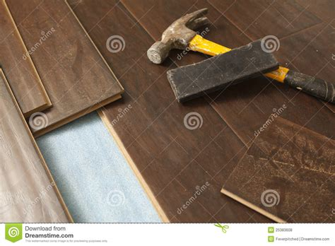 flooring hammer hammer and block with new laminate flooring stock photo image 25383608