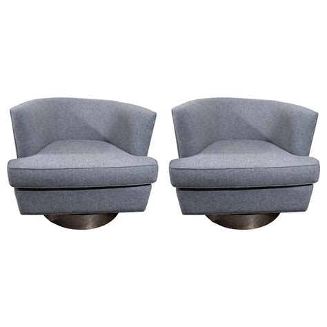 pair of milo baughman swivel chairs at 1stdibs
