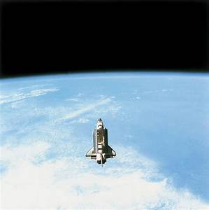 Aerial View Of The Space Shuttle In Orbit Above Earth ...
