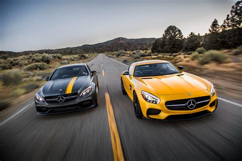 Mercedes Sport Car Wallpaper by Two Yellow And Black Mercedes Sports Cars Hd