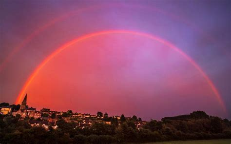 Spectacular Red Rainbow Illuminates Historic English Town