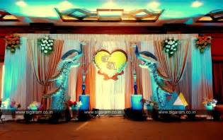peacock themed engagement stage decoration  hotel