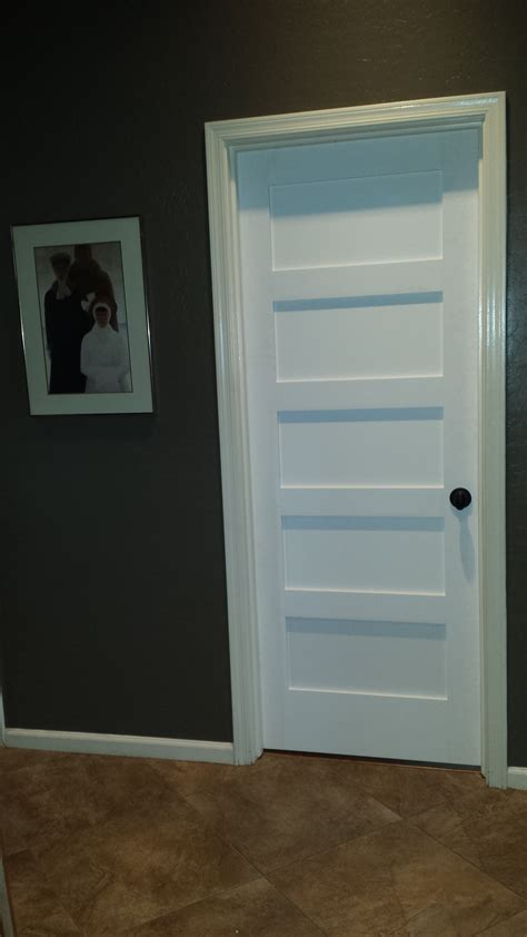 Shaker Style Closet Doors by Replacing Interior Hollow Doors With Solid Shaker
