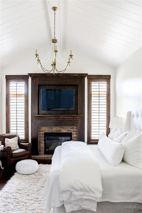 white bedroom  dark stained wood trim transitional