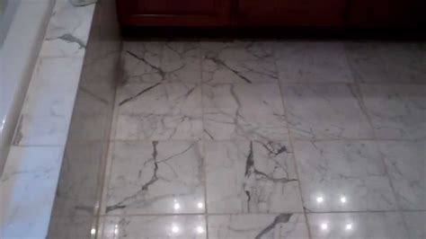 how to properly remove grout from a marble floot