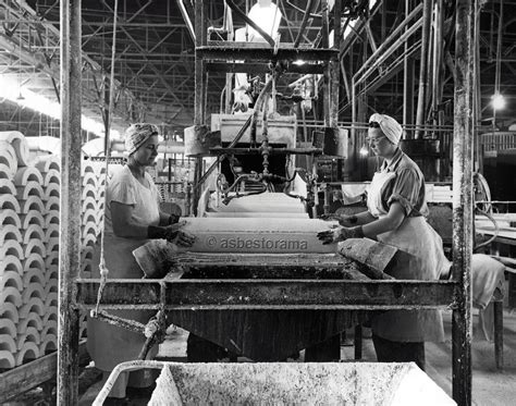 view  female johns manville workers apply canvas
