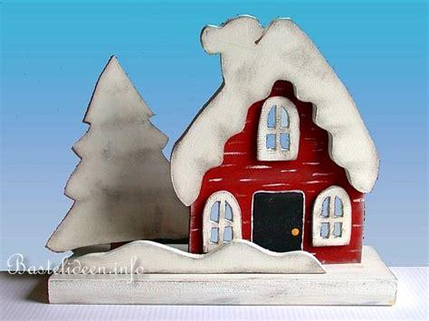 laubsaegearbeit basteln mit holz weihnachten huette