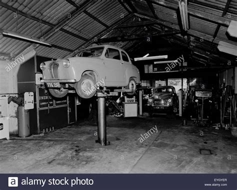 garage cardiff cardiff 1960 garage interior with car on hoist stock