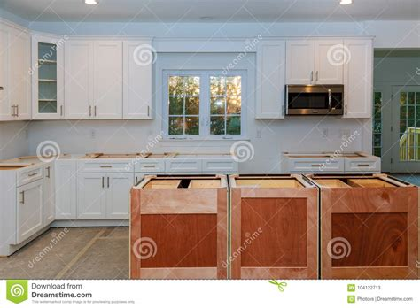 Installing New Induction Hob In Modern Kitchen Stock Image