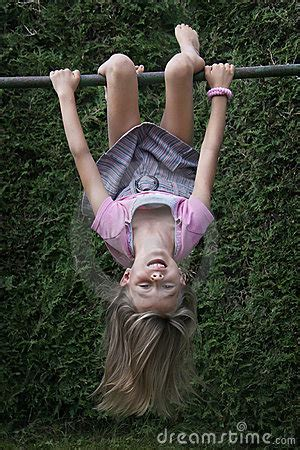 smiling girl hanging  climbing frame royalty  stock