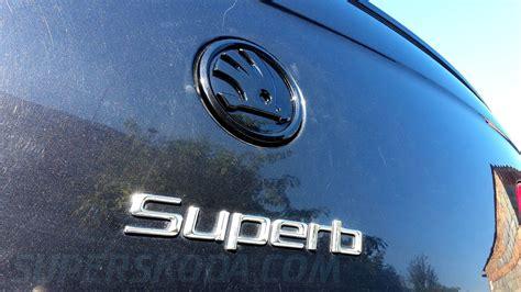 superb ii 09 13 emblem with new 2012 logo black monte carlo edition superskoda