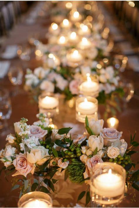 tischdeko mit kerzen hochzeitskerzen romantische warme licht