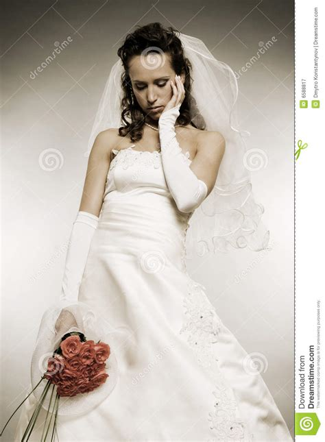 sad bride  bunch  roses royalty  stock