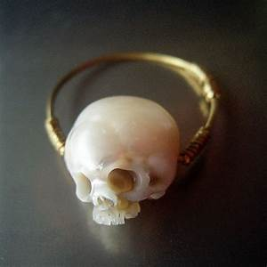 Miniature skulls carved from pearls used to create for Skull pearls