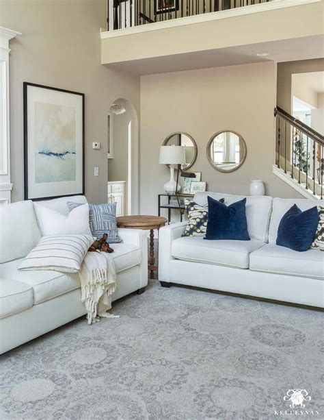 Neutral Living Room with blue accents White sofas with