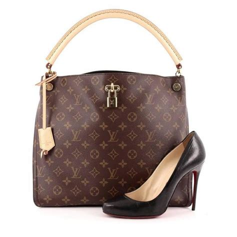 louis vuitton gaia handbag monogram canvas  stdibs