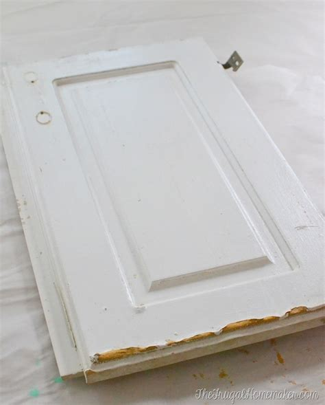 how to fix a cabinet door how to re paint your yucky white cabinets