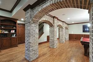 Basement with Brick Arches - Traditional - Family Room