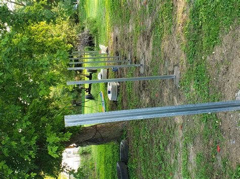 Metal Fence Post On Wooden Privacy Fence - Building ...