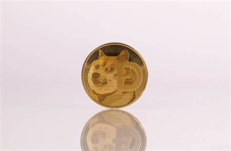 Golden Dogecoin on white background   💾 Marco Verch is a ...