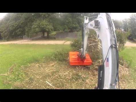 bobcat excavator mower devouring  shrub mulcher grinder  bush hog bushog youtube