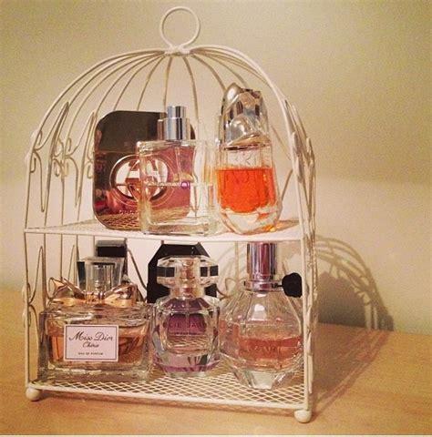 great idea  organizing multiple perfumes   dresser