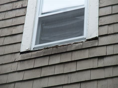 Exterior Window Sill Installation by Window Rehabilitation Building America Solution Center