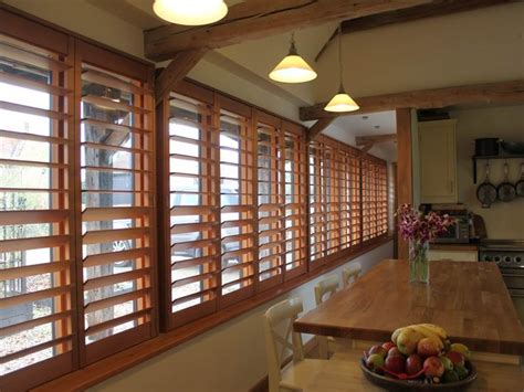 red cedar wood shutters  large kitchen windows