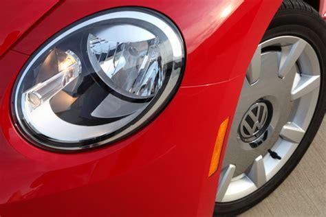 vw beetle headlight torque news