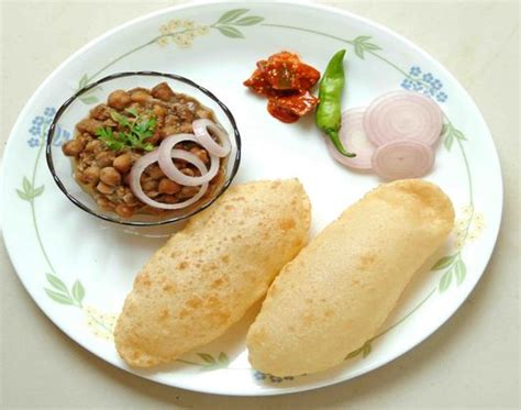 Chole bhature is a famous indian dish. 20 Popular Foods To Eat In Punjab - Crazy Masala Food