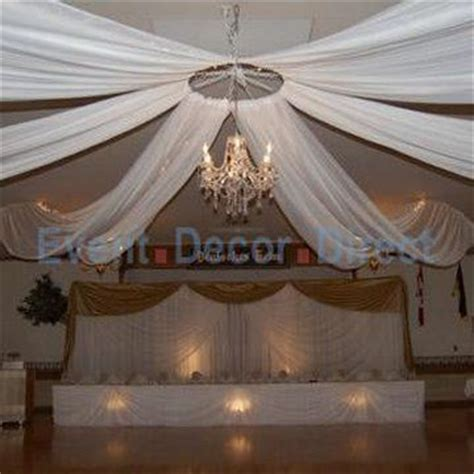 wedding ceiling decor perhaps a hula hoop around the chandelier lots of tulle and led lights