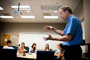 What motivates professors to teach pre-college students?