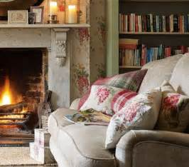 cottage livingrooms keeping warm by the open in a cottage living room country