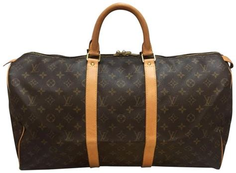 louis vuitton keepall   dustbag luggage tag handle