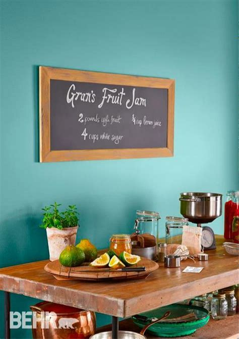 brighten up your kitchen with behr paint in a light blue color this soft color looks great with
