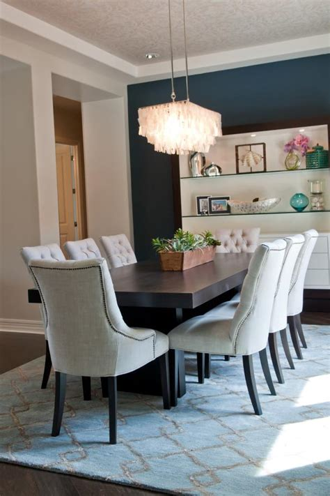 blue transitional dining room  eye catching chandelier