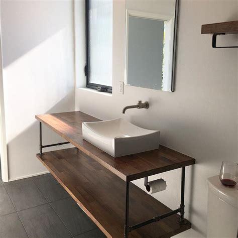 floating bathroom vanity  pipe industrial restroom