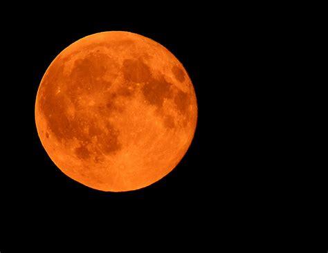 orange red moon rises over palouse wsu news washington