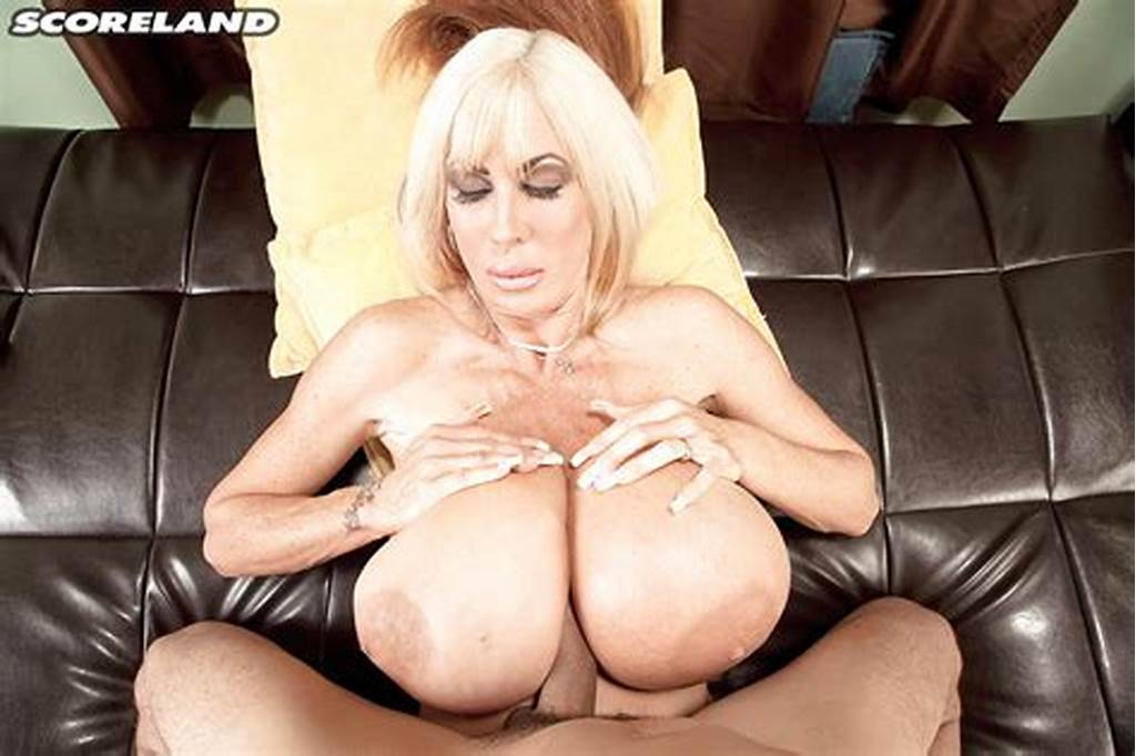 #Older #Blonde #Elizabeth #Starr #Using #Monster #Tits #To #Deliver