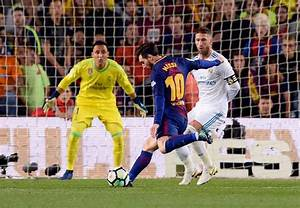 Messi strike helps 10-man Barcelona earn draw against Real ...
