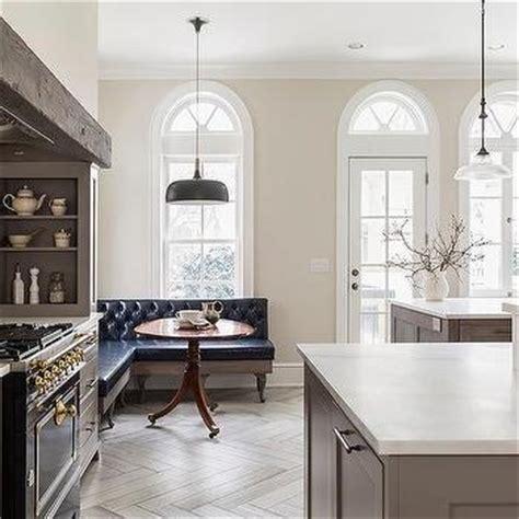 gray french kitchen  la cornue albertine stove  satin chrome polished brass french