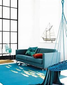 1001 idees deco salon bleu canard paon petrole du With tapis de yoga avec canapé bleu vintage