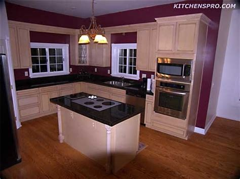 kitchen island stove layout with stove in island sink and oven