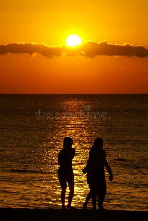 brilliant sunset   beach  kuta bali stock photo