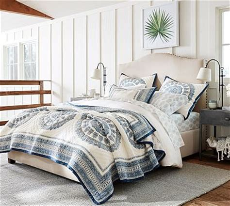 raleigh upholstered nailhead camelback tall bed