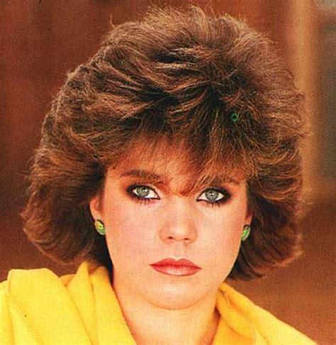 hair big bangs winged sides 80s hair makeup in