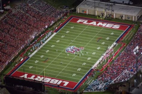 liberty university making surprise jump   fbs football